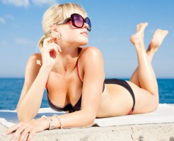 6337706 - attractive young blond woman in sunglasses at the sea